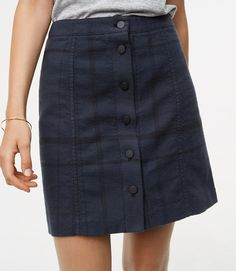 $69.50 Buttons add a perfectly tailored twist to this smart plaid skirt