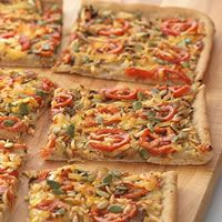 Recipe of the Day: No need for delivery this weekend! This Carmelized Onion and White Bean Flatbread tastes like a treat but is made with a mix of healthy, delicious ingredients like white beans, caramelized onions, plum tomatoes, and shredded cheese. Plus, the recipe packs in a hefty dose of protein to fill you up! #healthyrecipe #pizzarecipe #healthypizza #recipe #pizza #protein #highproteinrecipe