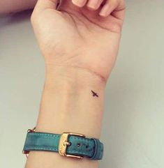 This is a simple small tattoo of a black swallow on the left side of the wrist of the left hand. The tattoo can be a great selection for people that aim high in life, just as a swallow flies. #tattoofriday #tattoos #tattooart #tattoodesign #tattooidea