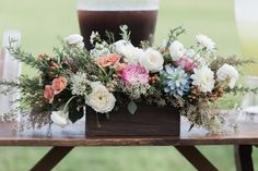 Romantic color palettes and luscious greenery take a drink station from ordinary to stellar for a rustic chic barn wedding at the Historic Barns of Nipmoose. Chelsea Proulx Photography, Florist: Anthology Studio