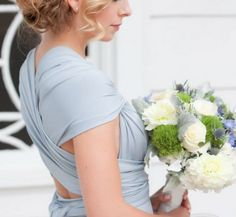 Pretty dusty blue bridesmaid dress paired with a beautifully textured bouquet of white, blue and green