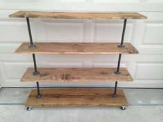 This storage rack is built from recycled iron piping and reclaimed wood. it will add a touch of class to a loft, office, rustic style home