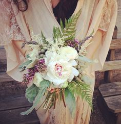 Bohemian wedding bouquet featuring peonies, lilacs, ferns and ranunculus  Flowers by us! stemsbrooklyn.com