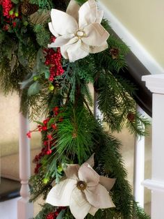I may give this idea a try this holiday season since my garland needs something a little extra. Felt Poinsettia Garland - Holiday Entryway Ideas on HGTV
