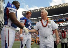 HONOLULU (Feb. 10 2008) Adm. Timothy J. Keating commander of U.S. Pacific Command shakes hands with Washington Redskins offensive tackle Chris Samuels before the coin toss of the 2008 Pro Bowl game at Aloha Stadium. U.S. Navy photo by Mass Communication Specialist 1st Class James E. Foehl (Released) - http://ift.tt/2a7gnqz