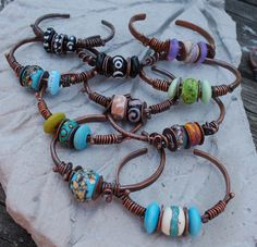 Thanks to Kiersten Kern for the tutorial.   Hand forged copper and Lampwork Beads made in my home studio.
