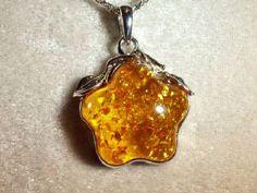 Amazing yellow amber star silver pendant