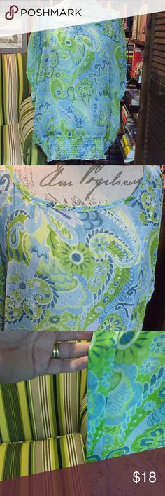 Wrangler Size XL blouse Lightweight blouse with elastic waist, short sleeves in wonderful spring colors. Colors are a aqua blue with greenish yellow paisley design. Blouse measures 25 inches across and is 27 inches long. My opinion is the blouse fits a little bigger. Wrangler Tops Blouses
