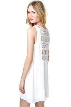 Totally adorable white shift dress featuring a V neckline and embroidered detailing at back. Flow...