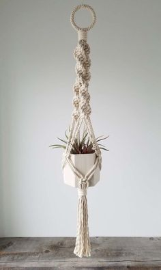 Hanging Planter, Includes both Hexagon Porcelain Pot and Macrame Cotton Hanger by RevisionsDesign on Etsy https://www.etsy.com/listing/471409382/hanging-planter-includes-both-hexagon