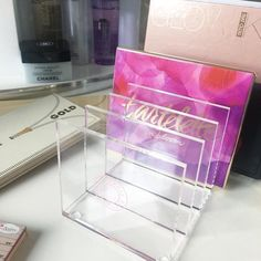 Keep your palettes organized and in reach with our new 8 Slot Palette Holder! Made from crystal clear acrylic, this item features eight individual slots and rubber feet on the bottom so you can stack