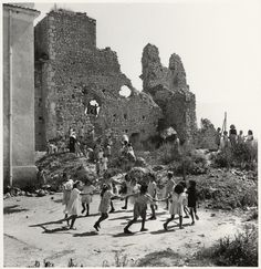 Girls playing in the ruins of a former orphanage, Monte Cassino, Italy, 1948  David Seymour