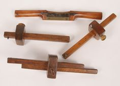 "Lot of four antique treen wooden tools including a wood plane and marking devices with wooden and brass screws, one branded J.F. Michal?, one with brass inlay.  Wood plane with worn impressed mark, ""___  ___tage Works, Sheffield\"", 11\"" long./3\"" blade.  All very good."