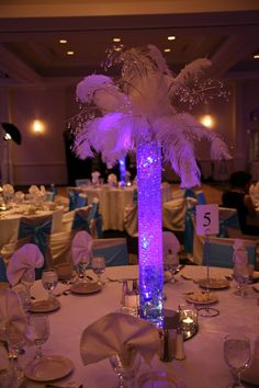 lighted tree centerpieces for weddings | LED Submersible Tea Lights in table vases. Love these.