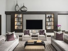 Sitting room with a pair of upholstered chairs, coffee table and moder sofas @ddginteriors   #luxuryinteriors #interiordesign