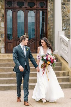 Sweet bride and groom holding hands. Bouquet by Gertie Mae's Floral Studio, bride's dress by Jenny Packham, groom's suit from The Modern Gent, image by Vue Photography at 2400 On The River in Ranger, GA.