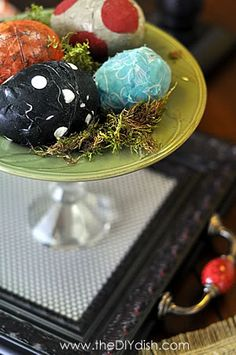"""I'm on this...Fun for kids to do...plastic easter eggs (yes, the bright purple and pink ones you can find!) and covered them with fabric and Mod Podge. Other eggs were covered with small pieces of masking tape and painted for a """"crackled"""" look."""