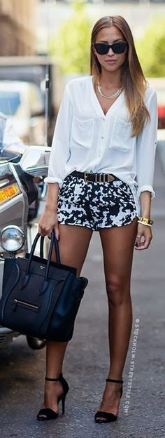 White shirt, black patches shorts and handbag street style