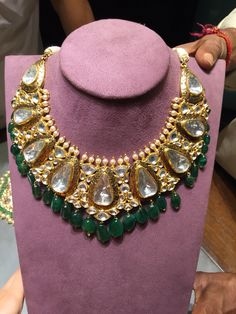 A very traditional Jaipur style polki necklace with emerald drops. A beautiful piece for an Indian bride from Jewels by Rakesh Khanna. #polkinecklace#emeralds#uncutdiamonds#bridaljewellery#gold#nofilter#indianjewellery#jewelsbyrakeshkhanna.