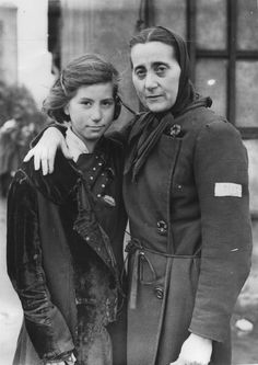 "The few ""lucky"" ones: A Jewish woman and her daughter after their release from a German slave labor camp. They worked at an ammunition plant."
