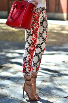 Love these pants with the overlapping black and red lace design. Paired with the red bag and a simple shoe it combines modern with classic.