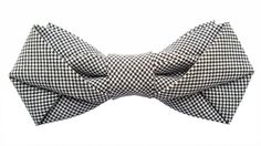 """4.75"""" x 2"""" ; pre-tied. Laurent Desgrange is a young French designer and artist. He spent his childhood in Tahiti and Eastern Islands. He lives and works in Paris. Laurent's collections are carefully hand made in his Parisian atelier. Each bow tie comes with a black satin ribbon and a clip. Wear as a bow tie, belt, head band, hair clip or on the lapel of your jacket. The possibilities are endless!"""