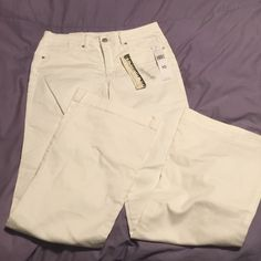 Brand new Jones New York flare white pants Perfect condition.  Always meant to get them hemmed but haven't yet.  I love the cut.  Just too long. Love the double pocket detail! Jones New York Jeans Flare & Wide Leg