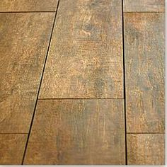 Porcelain tile that looks like wood! JUST did my hall bathroom with this (the grey tone version).  I used it as my shower walls and floor.  Looks just like driftwood!  GORGEOUS!