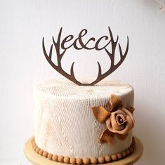 Personalized antlers wedding cake topper, rustic wooden cake topper, deer antlers topper. Please be sure to write the two initial letters in the notes section at check out. Size: 4 tall x 6 wide We offer this design in beech, mahogany, cherry, walnut, oak, wenge, golden front and silver front. Thank you for visiting our shop and feel free to contact us if you have questions regarding out products.