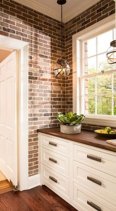 Fresh Hanging Cabinets On Brick Wall