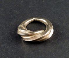 Old silver ring from the Fulani people of West Africa, also called Peul by the french. This sort of rings were cast with the lost wax technique and then forged to make the decoration. Some of the Fulani rings were used either as a ring or as hair adornment. It can make also a beautiful pendant.  Fula people or Fulani (Peul in french) are an ethnic group spread over many countries, predominantly in West Africa, but found also in Central Africa and Sudanese North Africa.  The inner diameter of…