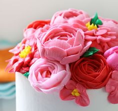 A beautiful spring-like cake inspired by HGTV magazine! Lovely buttercream flowers and a delightful layer pattern on the inside!