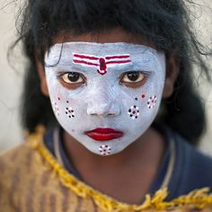 Little girl with make up in Kumbh Mela, Allahabad, India. By Eric Lafforgue.