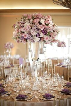 love this wedding reception table! gold table linens and chairs, and tall centerpiece with lavender, blush, and white flowers