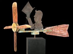 Antique Whirligig, Man Tipping Top Hat, Circa 1900, facing left angle view