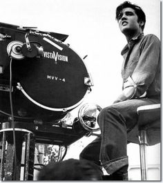 """Elvis sitting on the camera crane with the Vistavision Camera on set of """"Loving You"""". Elvis' hairdresser suggested they dye his hair jet black - said it would go better with his eyes. Elvis Presley Posters, Elvis Presley Movies, Elvis Presley Photos, Lund, Rare Pictures, Funny Photos, Moving Pictures, Mississippi, Divorce"""
