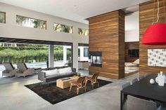This house in Winter Park, Florida, was designed to integrate the kitchen, living, and dining rooms with a patio and swimming pool out back.  Courtesy of Stephen Allen Photography.