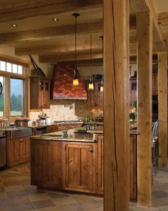 Google Image Result for http://www.timberhomeliving.com/wp-content/uploads/2011/08/Timber-Frame-Home-Post-and-Beam-rustic-Kitchen-Island-with-granite-counter-tops-.jpg