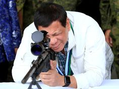 "Philippines President Rodrigo Duterte checks the scope of a sniper rifle during the turnover ceremony of China's urgent military assistance given ""gratis"" to the Philippines, at Clark Air Base, near Angeles City, Philippines. Rodrigo Duterte, Davao, I Am Here Now, Insulting Quotes, President Of The Philippines, America Quotes, Collateral Damage, National Police, War On Drugs"