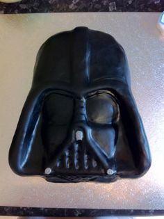 Do not underestimate the technological cake you have created! Darth Vader cake mould covered in black fondant icing and a little edible silver paint to finish it off.