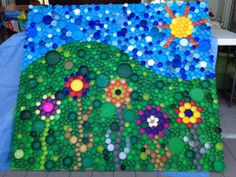 My first big bottle cap art project. Got the piece of plywood from the neighbors trash pile and have been saving bottle caps for a while. I am planning on hanging it on the wall at my preschool.