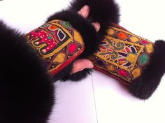 Wrist warmes made of merino lam and blackdyed fox,with old handembroidery from India. handmade Jane Eberlein, Copenhagen Denmark.  www.samarkand.dk