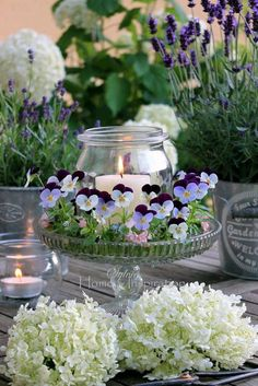 Hearts' ease, hydrangeas and lavender, so pretty with candles...