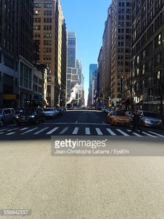 View Stock Photo of Person Walking On Zebra Crossing Against Cars On City Street. Find premium, high-resolution photos at Getty Images.