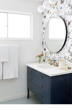 Playful nature-inspired wallpaper applied above vanity