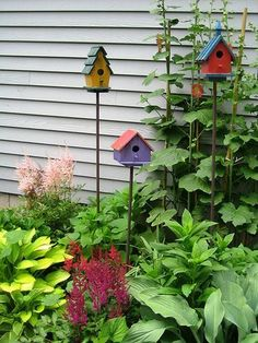 I love the colors. This would be lovely on the south side of our home. -Garden Ornaments- #birdhouses #gardenfences