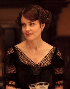 Cora, Countess of Grantham. This costume was actually reused, later: http://www.recycledmoviecostumes.com/victorianedwardian154.html