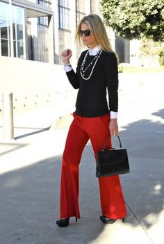 black sweater and red pants