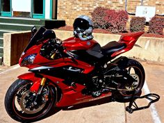 Apple red Yamaha R6 with a fighter jet helmet awesome