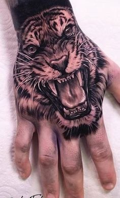 Hand tattoos for men are trendy right now. Getting a hand tattoo is a huge commitment. In this article we have collection trendy hand tattoos for men. Tiger Hand Tattoo, Skull Hand Tattoo, Hand Tats, Lion Hand Tattoo Men, Mens Tiger Tattoo, Lion Tattoo Sleeves, Best Sleeve Tattoos, Hand Tattoo Images, Hand Tattoos For Women